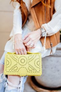Joie shearling vest, Chloé ankle boots, and yellow clutch