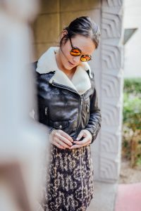 Black bomber jacket and Joie dress