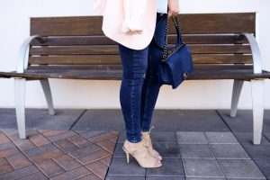 Pink Joie jacket and blu Chanel Boy bag