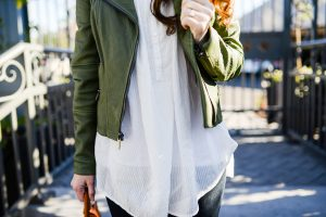 White shirt and military green leather jacket