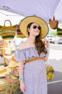 Call me Lore wearing and off shoulder dress from Lisa Marie Fernandez