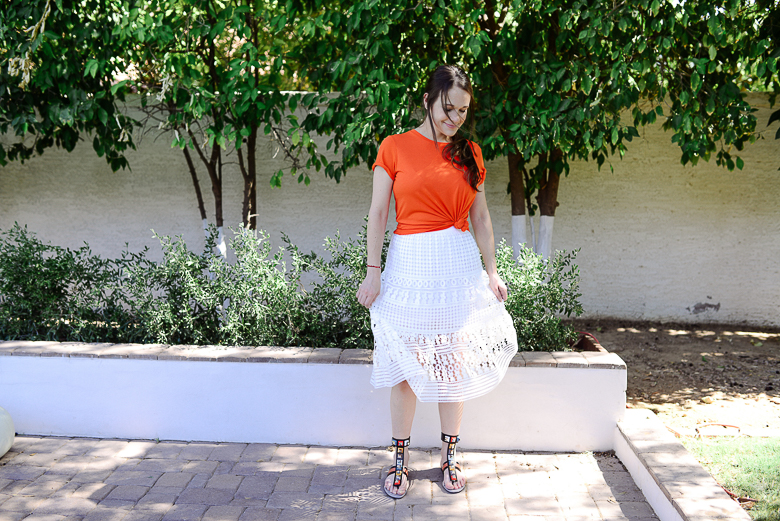 Call me Lore wearing DVF white skirt and Fendi Sandals